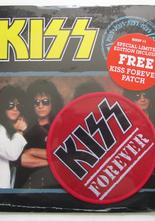 "Kiss Forever (Remix) / The street Giveth and the Street Taketh Away 7"" singel med patch"
